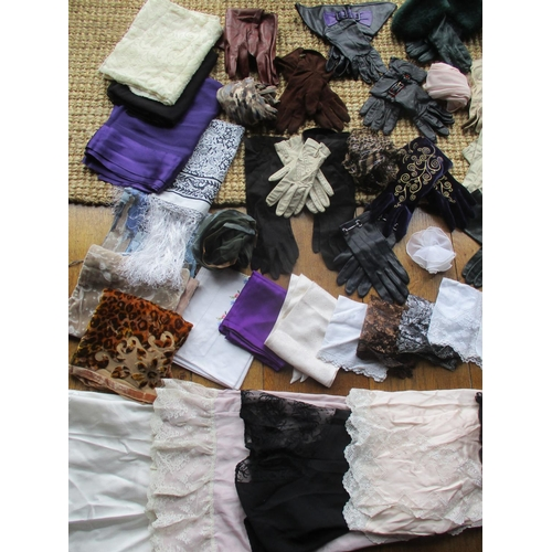 27 - Twentieth century leather gloves and long sleeved evening gloves, a selection of ladies handkerchief...