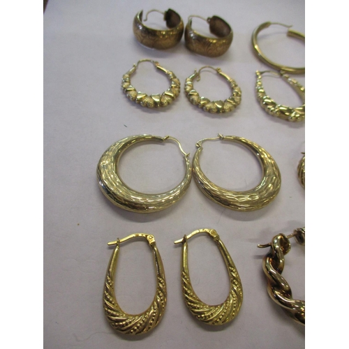 6 - Six pairs of 9ct gold hoop earrings stamped 375, 13.8g, together with five pairs of yellow metal hoo...