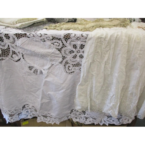 34 - A 19th century lace panel, double sided, with net and ribbon frill on all sides, hand sewn with flor...