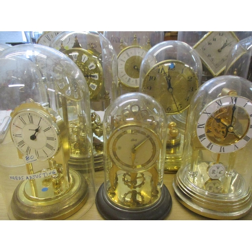 12 - Eight anniversary clocks with glass and plastic domes, together with three extra domes  Location: RA...