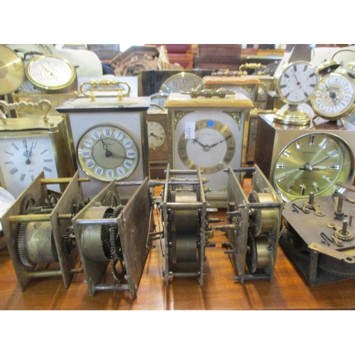 13 - A quantity of vintage mantle, carriage and wall clocks, together with a brass cased ship's gauge  Lo...