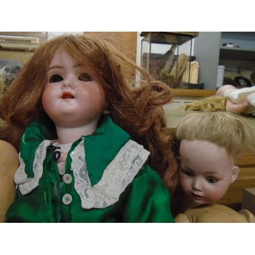 39 - A Schoenau and Hoffmeister bisque headed girl doll, with sleep eyes, open mouth showing three teeth,...