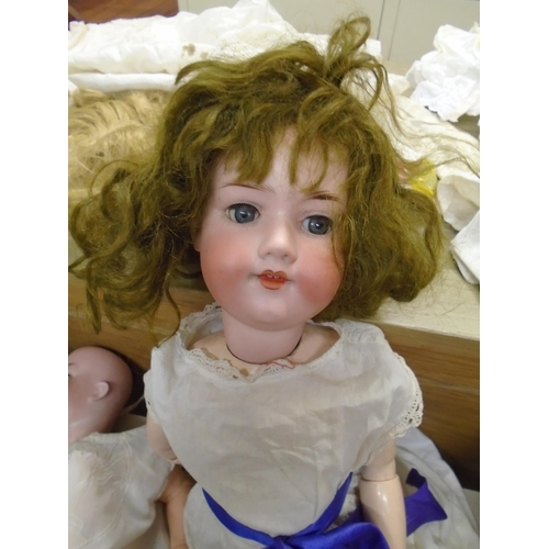 40 - A Porzellanfabrik - Burggrub (Schoenau & Hoffmeister) - a bisque headed character baby doll, blue sl...