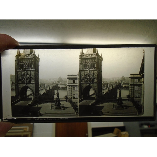 41 - A selection of stereoscope slides depicting landscapes and city scenes to include those of Prague Lo...