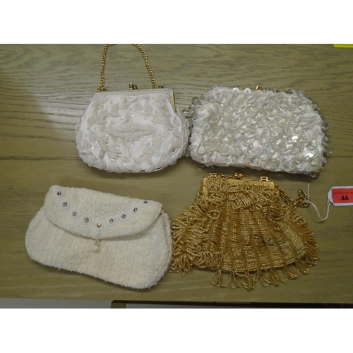 44 - A group of four vintage beaded evening bags  Location: 9:3...
