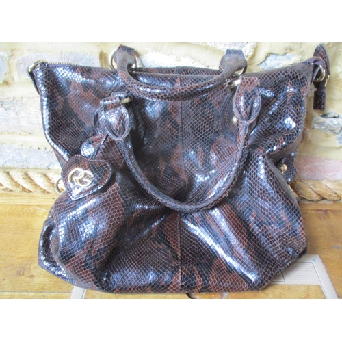 14 - Four 20th century leather bags in a mock reptile style comprising a black patent leather ladies brie...