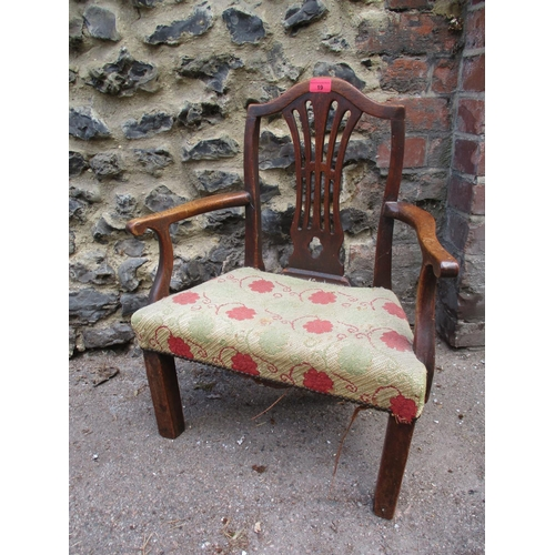 19 - A Georgian walnut apprentice/child's chair in the Hepplewhite style 63cm high x 52cm wide (at widest...