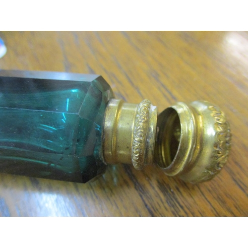 8 - A Victorian double ended glass scent bottle, the faceted green glass body mounted to either end with...