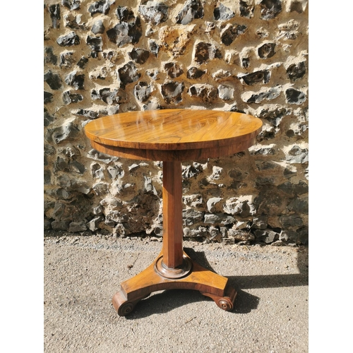 176 - A William IV rosewood side table, with circular top above a central faceted column on a triform base...