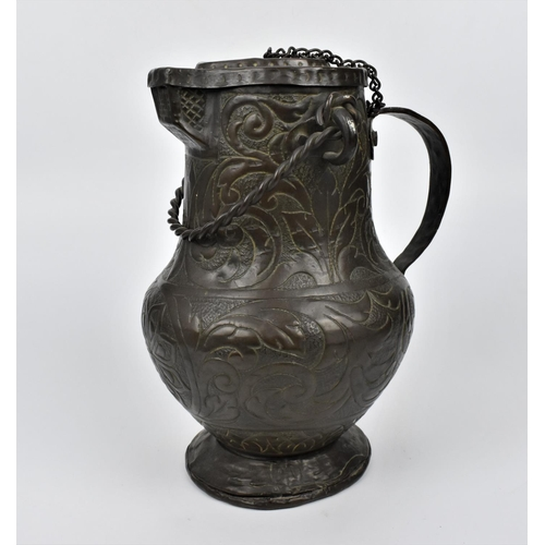 72 - A 19th century or earlier Indo-Persian embossed copper lidded ewer, with foliate patterns throughout...