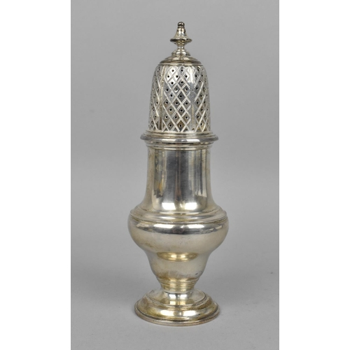 92 - A 20th century silver sugar sifter, London 1964, of pedestal lighthouse form with spreading circular...