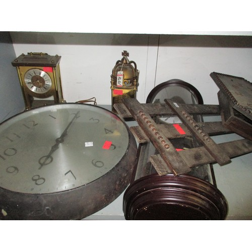 47 - A mixed lot of clocks to include a wall hanging pendulum clock in a domed glazed and wooden case, ha...