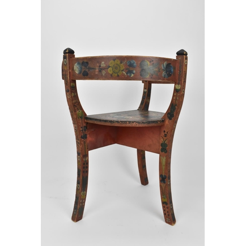 195 - A Norwegian folk art painted and stained wooden chair with horse shoe back, on three legs, designed ...