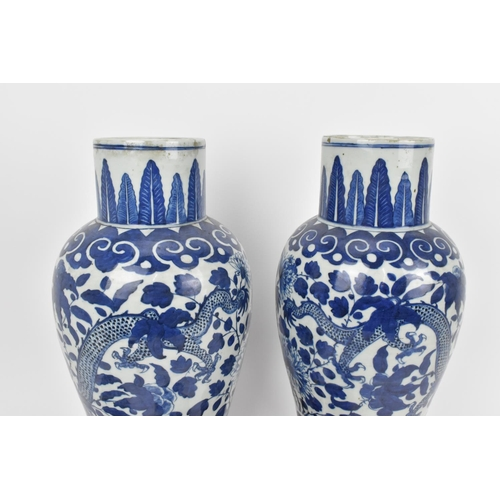 3 - A pair of Qing dynasty blue and white porcelain lidded vases, 19th century, of baluster shape with X...