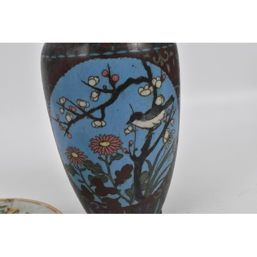 36 - A late Qing dynasty blue and white porcelain moon flask vase, with central panels either side depict...