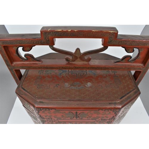 4 - A Japanese Meiji period red lacquer sage jubako (picnic basket) with three octagonal shaped stacking...