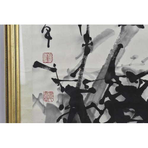 52 - A large Chinese ink painting on paper laid on silk, depicting bamboo branches with calligraphy to th...