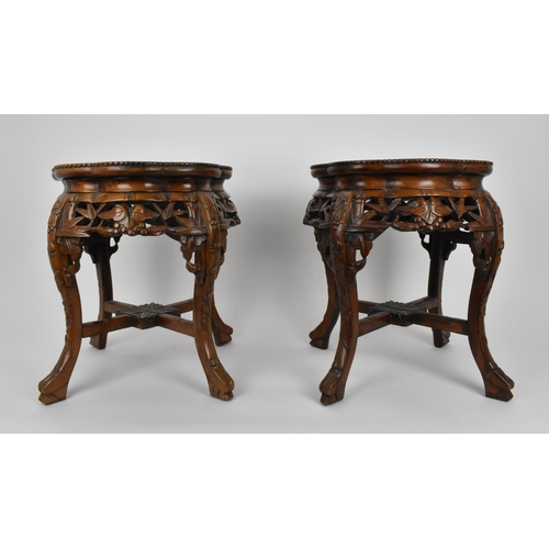 75 - A pair of Chinese carved hardwood and marble jardiniere stands, with beaded rim and pierced foliate ...
