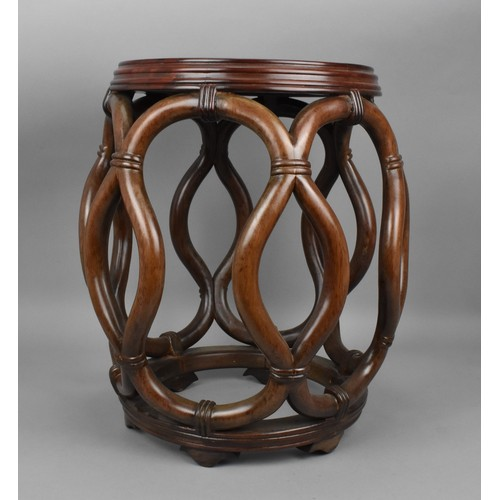 48 - A Chinese hardwood barrel seat, with open work throughout, 44 cm high x 40 cm diameter...