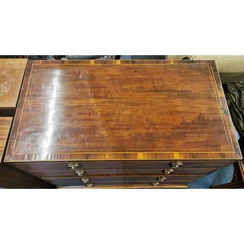 134 - A Georgian straight fronted chest of drawers with string inlay, four graduated drawers with twin hoo...