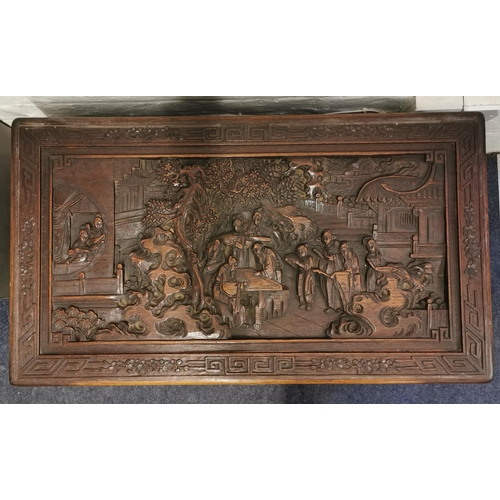 38 - An early 20th century Chinese camphor chest, with carved figural scenes to the top and all sides, ra...