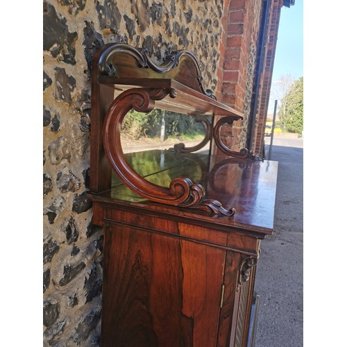 131 - A Regency rosewood mirrored back chiffonier, surmounted with a moulded pediment, the cabinet with tw...