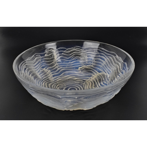 15 - A René Lalique opalescent glass 'Dauphins' pattern bowl, mid century, pattern number 423, with stenc...