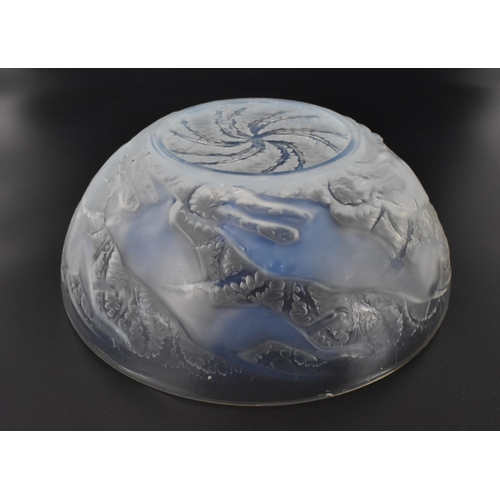 16 - A René Lalique 1920s opalescent glass 'Chiens' pattern bowl, model number 3214, with moulded leaping...