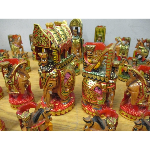 42 - An Indian carved and painted chess set A/F Location: RAB