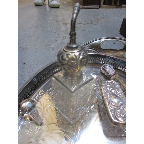 31 - A selection of silver plate, cut and engraved glass, cut glass and silver or silver plated topped dr...