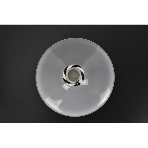 27 - A small cloud glass vase by Darryle Hinz (American School), of squat form with black and white cane ...