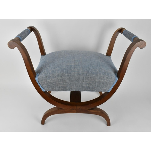 47 - A 19th century Biedermeier upholstered walnut window seat or curule stool, with new blue fabric upho...