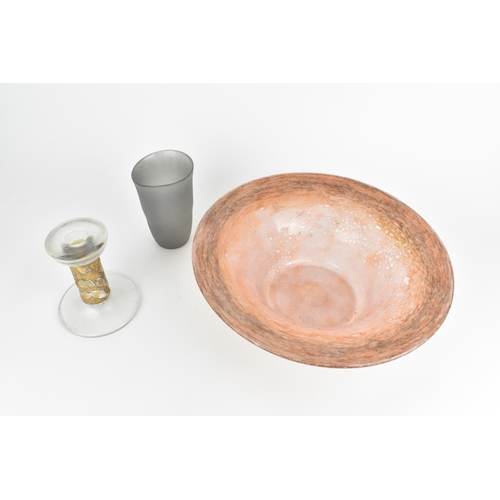 60 - A large post war studio glass UB shaped bowl, in the Monart style in mottled pink with large everted...