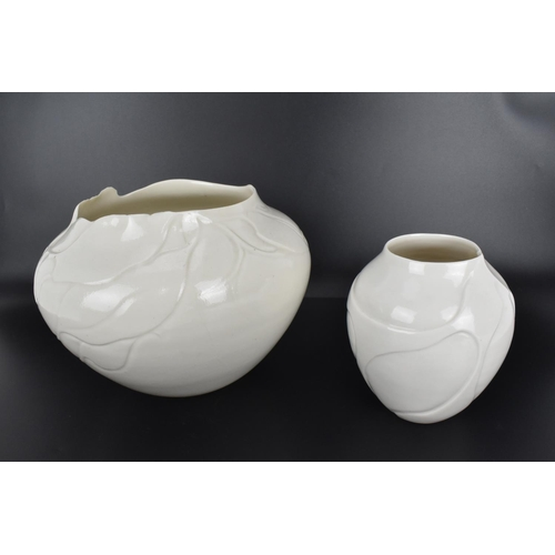 56 - A collection of 1980s porcelain pieces by Vivienne Legg, comprising two vases of bulbous form with v...