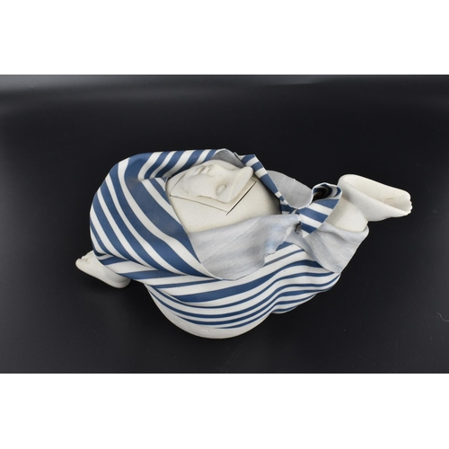 33 - A French 1980s ceramic figural lidded teapot by Bottagisio and Decoux, the handle and spout modelled...