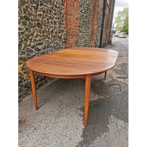 44 - A 1960s Danish teak extending table and chairs by Skovmand & Andersen, the circular table with two a...