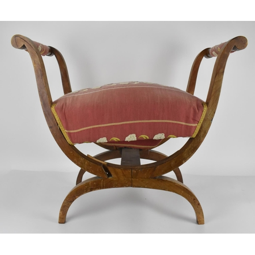 49 - A 19th century Biedermeier upholstered window seat or curule stool, with later upholstery, designed ...