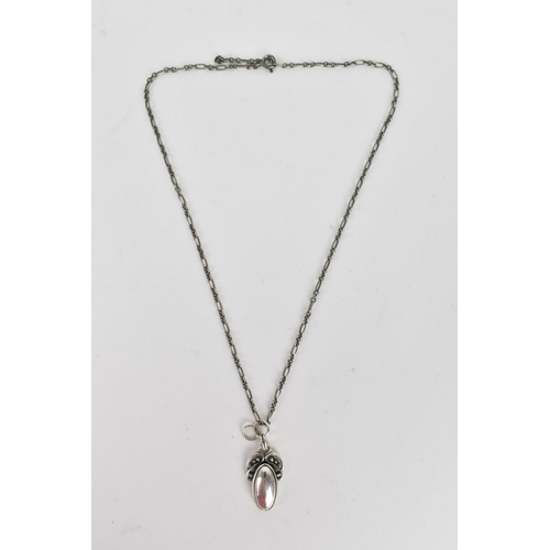 6 - A Georg Jensen sterling silver 2005 Heritage Collection pendant on a trace link chain, with original...