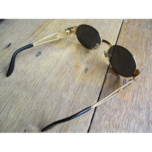 11 - A pair of Fendi ladies sunglasses with gold tone frame and temples, together with a Prada sunglasses...
