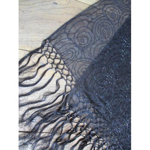 16 - A 20th century black sheer wrap with ornate beadwork and tassels Location: RWB...