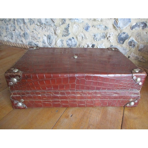 18 - A good quality 20th century brown leather weekend suitcase, British made, in a faux reptile design h...
