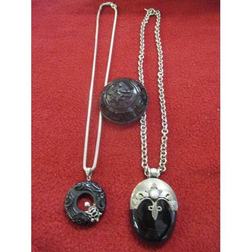 2 - A Victorian silver and jet pendant with inset pearl on a white metal chain together with a Victorian...