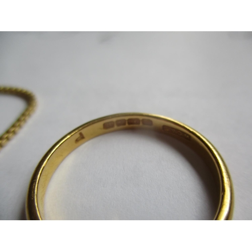 20 - A 22ct gold wedding band, 3.7g, together with a 9ct gold chain, made in Italy, 1.8g Location: Cab