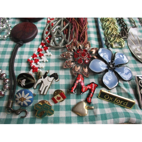 22 - Late 20th costume jewellery, mainly bead necklaces together with enamelled pin badges, gold tone cha...
