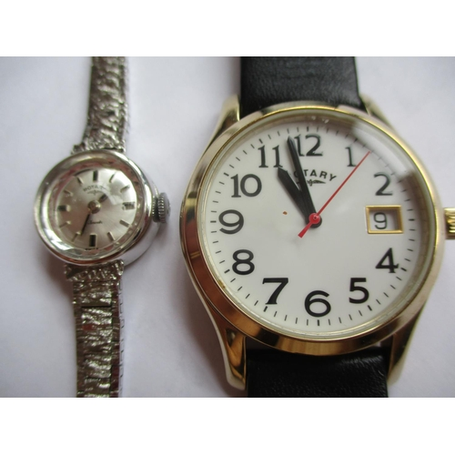 24 - Two Rotary watches, one a silver coloured ladies cocktail watch and the other a gent's watch with wh...