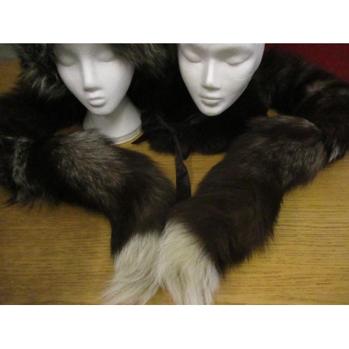 27 - A quantity of fur and faux fur accessories (display heads not included) housed within a cardboard ha...