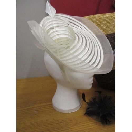 30 - A Jasper Conran fascinator in disc form, together with a cardboard hat box, a rattan beach bag and a...