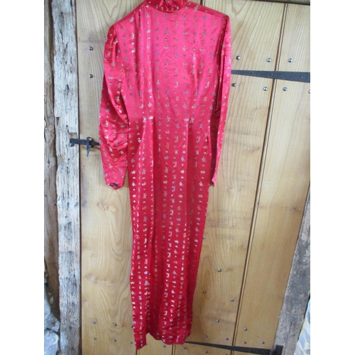 6 - A vintage Chinese red full length silk dress having a Mandarin collar, full length sleeves and decor...