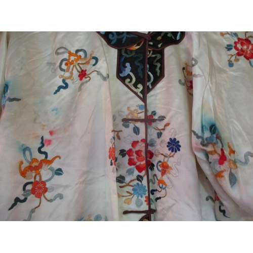 46 - Mid to late 20th century Chinese and Japanese clothing to include a Ying Tai Co padded silk jacket, ...