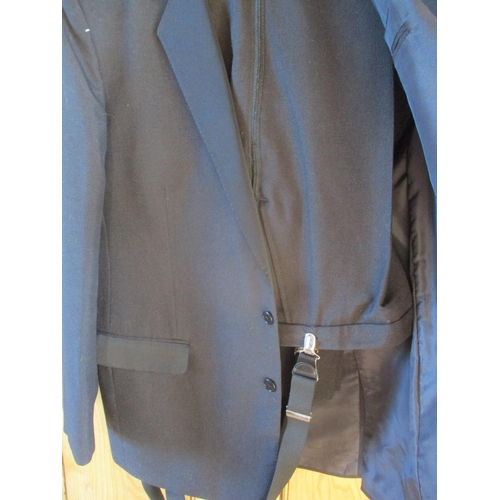 48 - A late 20th century Dunn & Co formal black two piece evening suit and bow tie with braces, 44/46